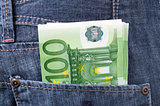 Euro banknotes in pocket of blue jeans trousers.