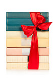 stack of book with ribbon like a gift isolated on white