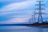 Row of electrical towers receding