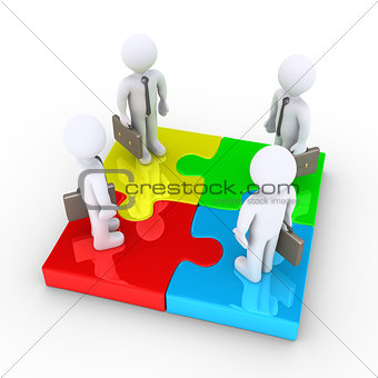 Four businessmen are united by puzzle pieces