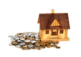Miniature house on coins pile - isolated on white