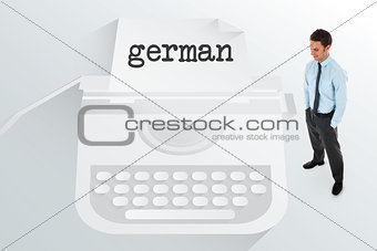 The word german and happy businessman standing with hands in pockets