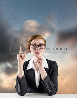 Composite image of thinking redhead businesswoman