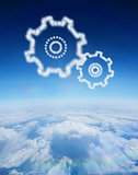 Composite image of cloud in shape of cogs and wheels