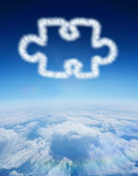 Composite image of cloud in shape of jigsaw piece