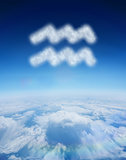 Composite image of cloud in shape of aquarius star sign