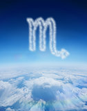 Composite image of cloud in shape of scorpio star sign