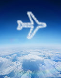 Composite image of cloud in shape of airplane