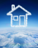 Composite image of cloud in shape of house