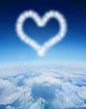 Composite image of cloud in shape of heart