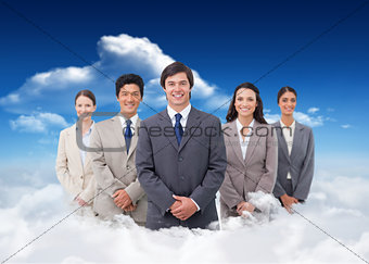 Composite image of smiling salesteam standing