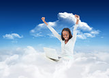 Composite image of young woman stretching while on the floor with her laptop