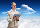 Composite image of pensive stylish businesswoman holding tablet