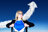 Composite image of businesswoman opening her shirt superhero style