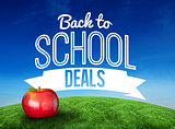 Composite image of red apple with back to school message