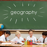 Geography against cute pupils sitting at desk
