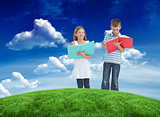 Composite image of brother and sister doing their homework together