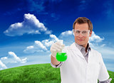 Composite image of young scientist working with a beaker