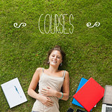 Courses against pretty student lying on grass