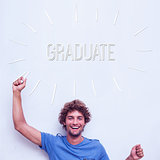 Graduate against happy student holding chalk