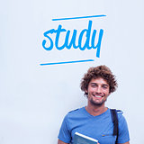 Study against happy student holding book