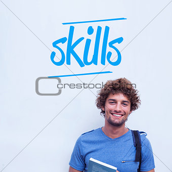 Skills against happy student holding book