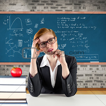 Composite image of thinking redhead teacher