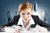 Composite image of redhead businesswoman sitting at desk typing
