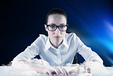 Composite image of businesswoman typing on a keyboard