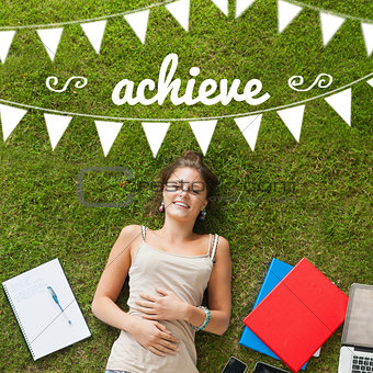 Achieve against pretty student lying on grass