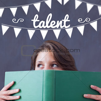 Talent against student holding book
