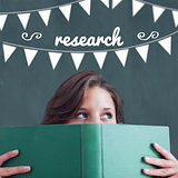 Research against student holding book