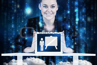 Composite image of businesswoman sitting at desk showing tablet