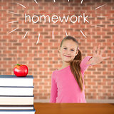 Homework against red apple on pile of books