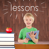 Lessons against red apple on pile of books