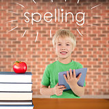 Spelling against red apple on pile of books