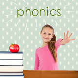 Phonics against red apple on pile of books