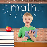 Math against red apple on pile of books in classroom