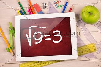 Composite image of digital tablet on students desk