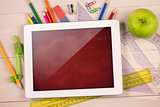 Composite image of digital tablet on students desk
