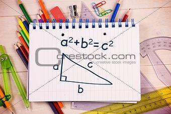 Composite image of trigonometry on notepad