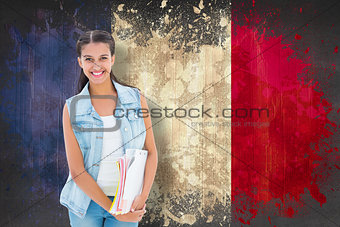 Composite image of student holding notepads