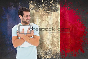 Composite image of student holding laptop