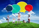 Composite image of happy students with speech bubbles