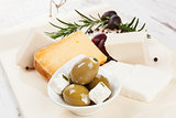 Luxurious cheese and olive background.