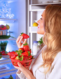 Woman eating strawberry