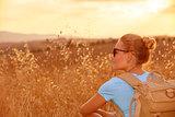 Enjoying wheat field in sunset