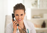Portrait of doctor woman talking phone