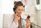 Doctor woman with medicine bottle talking phone