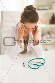 Portrait of stressed doctor woman in office
